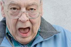 Seniors man with mouth open royalty free stock images
