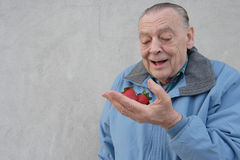 Seniors Man With Strawberries Stock Images