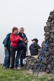 Seniors with map and child hiking outdoors royalty free stock photography
