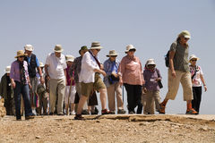 Seniors Masada. A tour guide leads a group of senior travelers at the ancient hilltop fortress of Masada in Israel Stock Photography