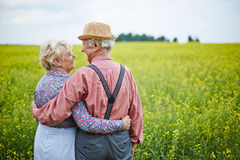 Seniors in meadow Royalty Free Stock Image