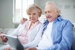 Seniors networking Stock Photo