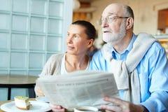 Seniors with newspaper Stock Photo