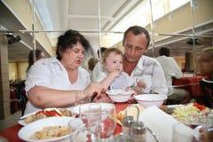 Seniors nourish child Royalty Free Stock Image
