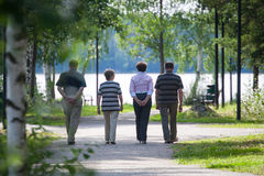 Seniors out walking at park stock photography