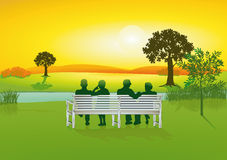 Seniors on park bench Stock Image