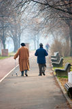 Seniors in a park walking Stock Photos