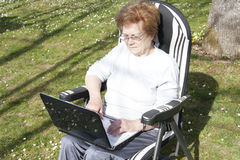 Seniors people with technology Royalty Free Stock Photography