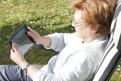Seniors people with technology Stock Images