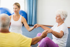 Seniors performing yoga. During sports class Stock Photography