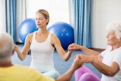 Seniors performing yoga Royalty Free Stock Photos