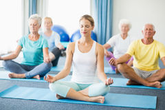 Seniors performing yoga. During sports class Royalty Free Stock Photography