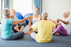 Seniors performing yoga. During sports class Royalty Free Stock Images