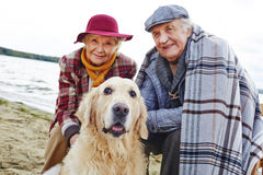 Seniors and pet Stock Images