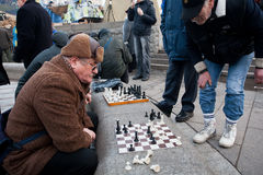 Seniors play chess on the street Royalty Free Stock Photography