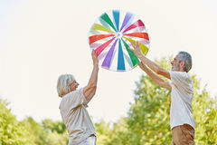 Seniors playing with a big ball Stock Photography