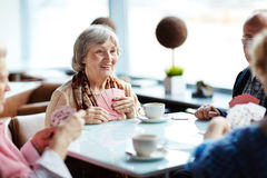 Seniors playing cards royalty free stock photo