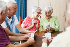 Seniors playing cards. In a retirement home Stock Image