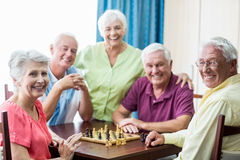 Seniors playing chess. In a retirement home stock photography