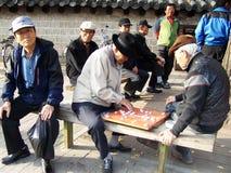 Seniors playing chinese chess Stock Photography