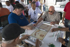 Seniors playing dominoes,Miami, Florida, United States Stock Images