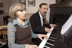 Seniors playing piano duet Stock Images
