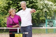 Seniors playing tennis Stock Photos
