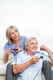 Seniors playing video games Royalty Free Stock Images