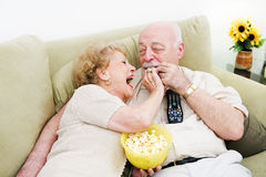 Seniors Popcorn Television Stock Photo