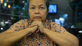 Seniors portrait, contemplative old caucasian woman staring at camera.  stock footage