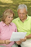 Seniors read paper Stock Photo