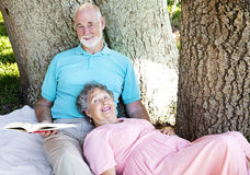 Seniors Reading Together Stock Images