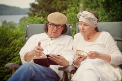 Seniors relaxing outdoors. Royalty Free Stock Photo