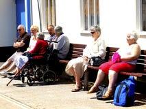 Seniors relaxing , Paignton, Devon. A group of seniors relaxing beside the harbour at Paignton,Torbay,South Devon,England,UK Royalty Free Stock Photos