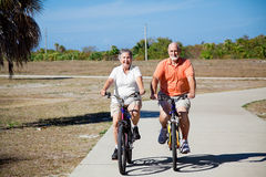 Seniors Riding Bicycles Royalty Free Stock Photography