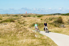 Seniors riding bicycles in dunes of Texel, Netherlands Stock Images