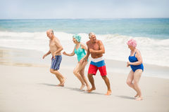 Seniors running at the beach Royalty Free Stock Photography