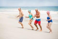 Seniors running at the beach Royalty Free Stock Photos