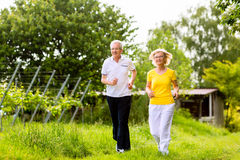 Seniors running in the nature doing sport Royalty Free Stock Photography