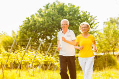 Seniors running in the nature doing sport Royalty Free Stock Photo
