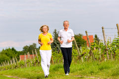 Seniors running in the nature doing sport Royalty Free Stock Photos
