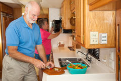 Seniors RV - Preparing a Meal Royalty Free Stock Photo