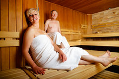 Seniors in sauna sweating and relaxing Royalty Free Stock Photos
