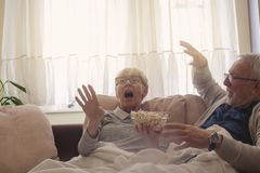 Seniors Shocked by TV stock images
