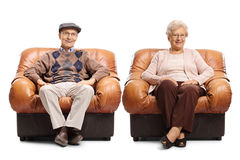 Seniors sitting in leather armchairs Royalty Free Stock Images