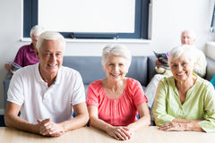 Seniors sitting at a table Royalty Free Stock Photography