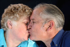 Seniors Smooching. Senior married couple being affectionate Royalty Free Stock Photos