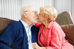 Seniors Snuggle Stock Photography
