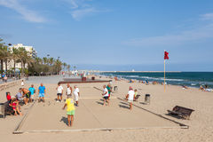 Seniors Spaniards play Bocce on sandy beach. Calafell, Spain - August 20, 2014: Seniors Spaniards play Bocce on a sandy beach in Calafell, small resort town in Stock Photo
