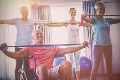Seniors stretching during fitness class. In retirement house royalty free stock images